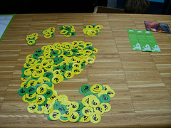 The GNOME foot logo made from yellow and green round stickers with the GNOME foot logo on them.