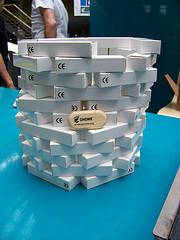 A hexagonal tower made of the bamboo GUADEC 2010 USB sticks in their white boxes, with one on display.
